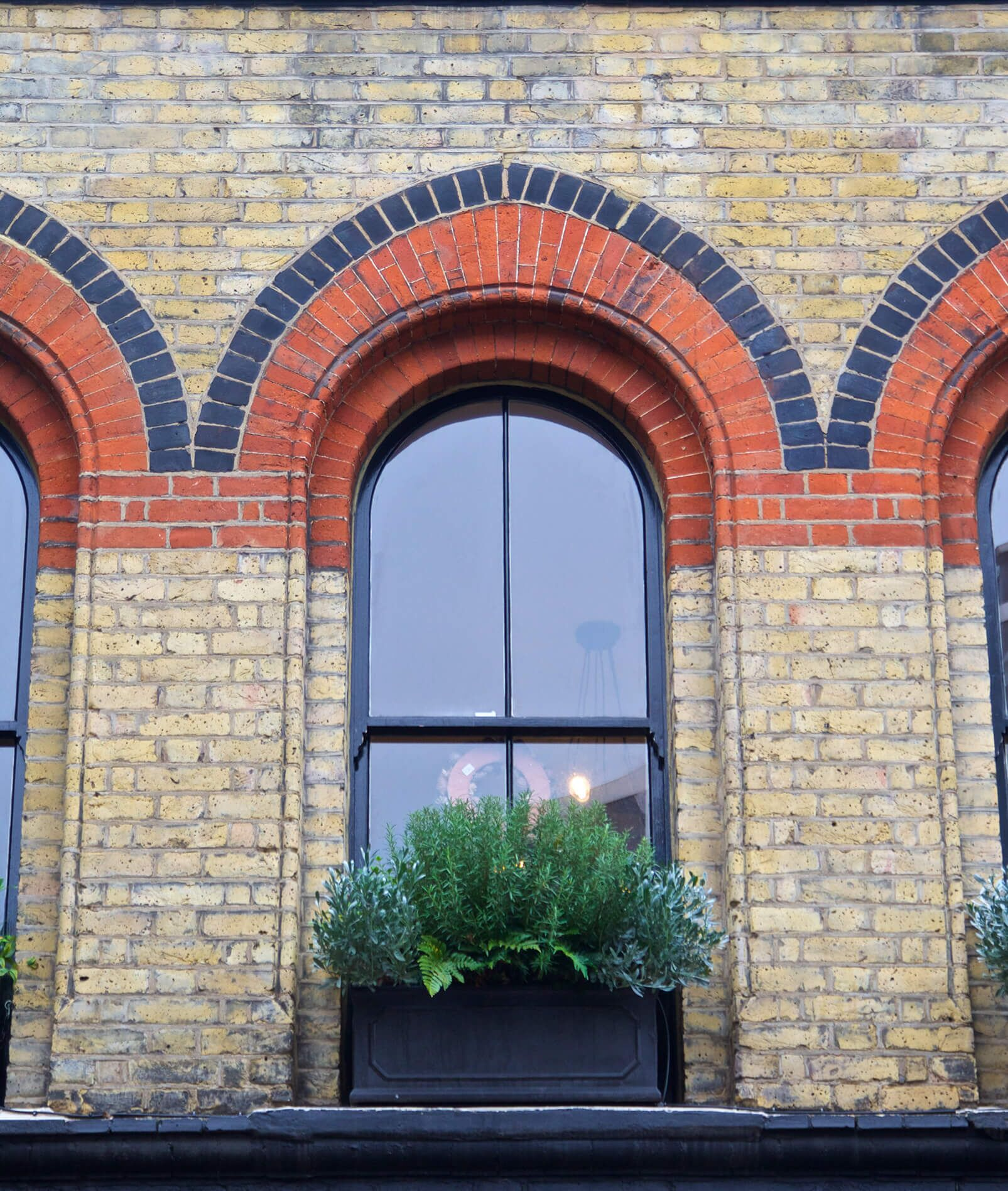 arched window of redbrick house