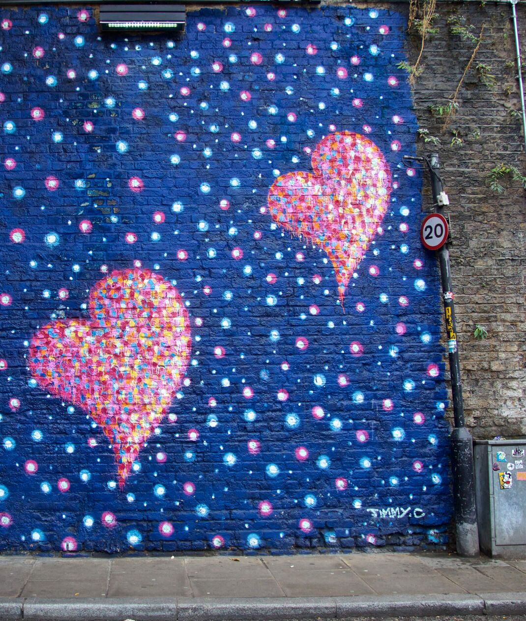 wall of graffiti with pink hearts