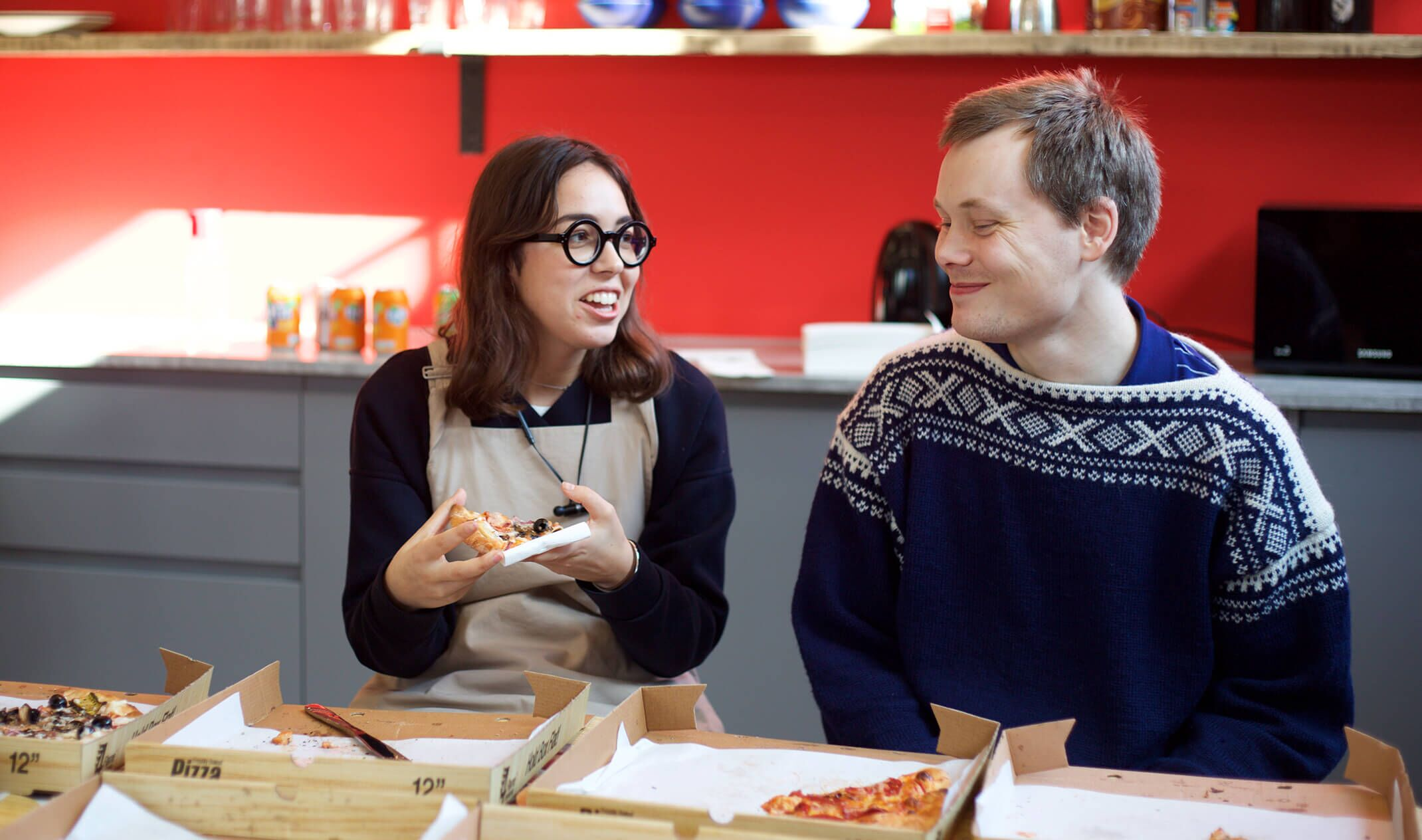 Two colleagues chatting while eating lunch