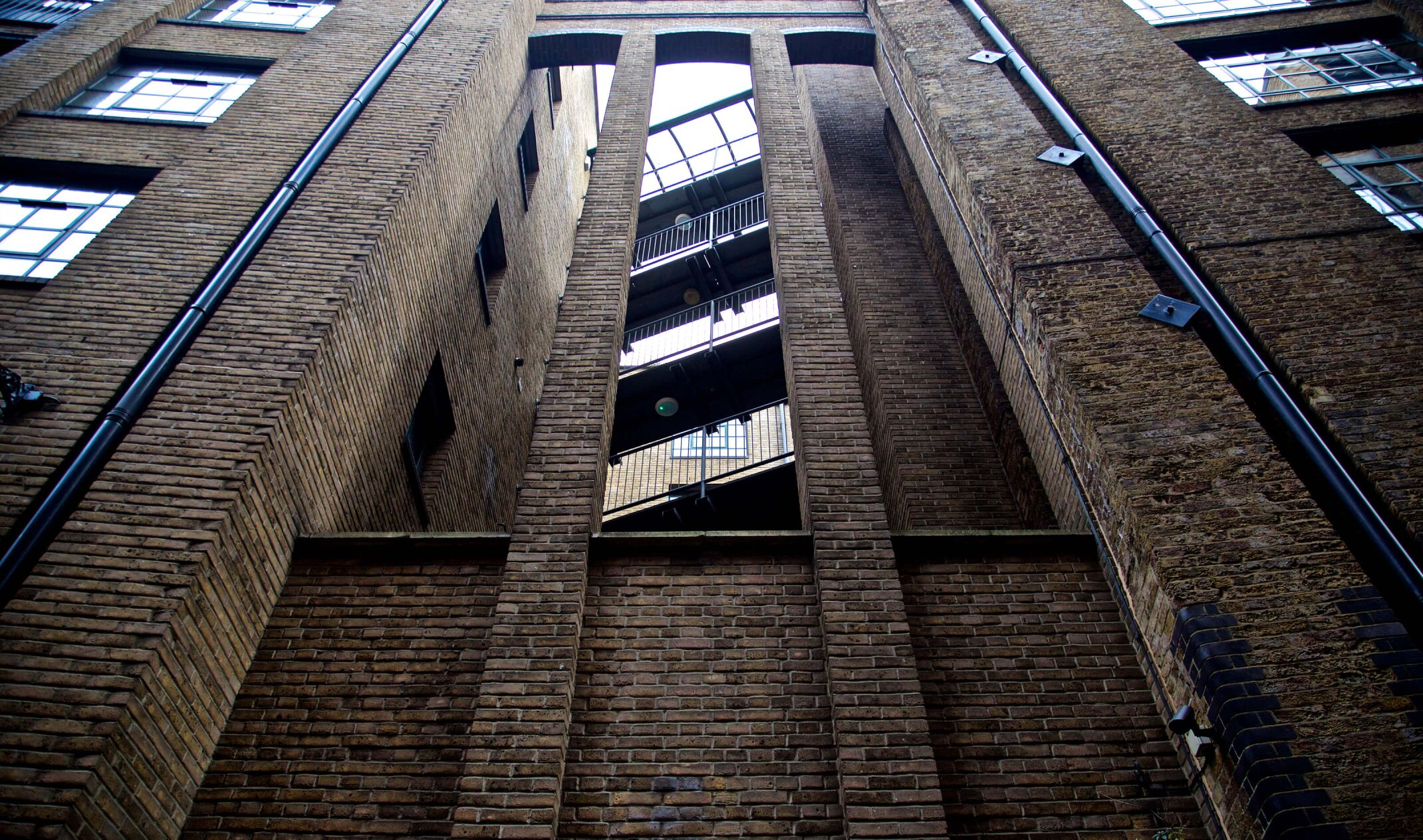 tall brick factory building with staircase