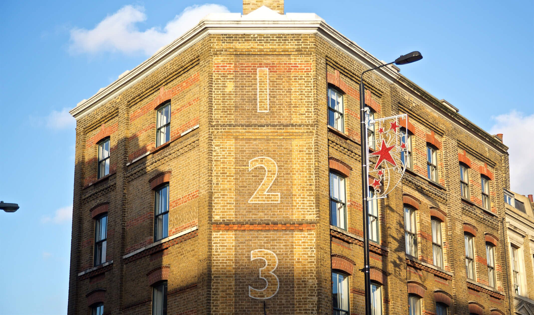 red brick building with one two three signage