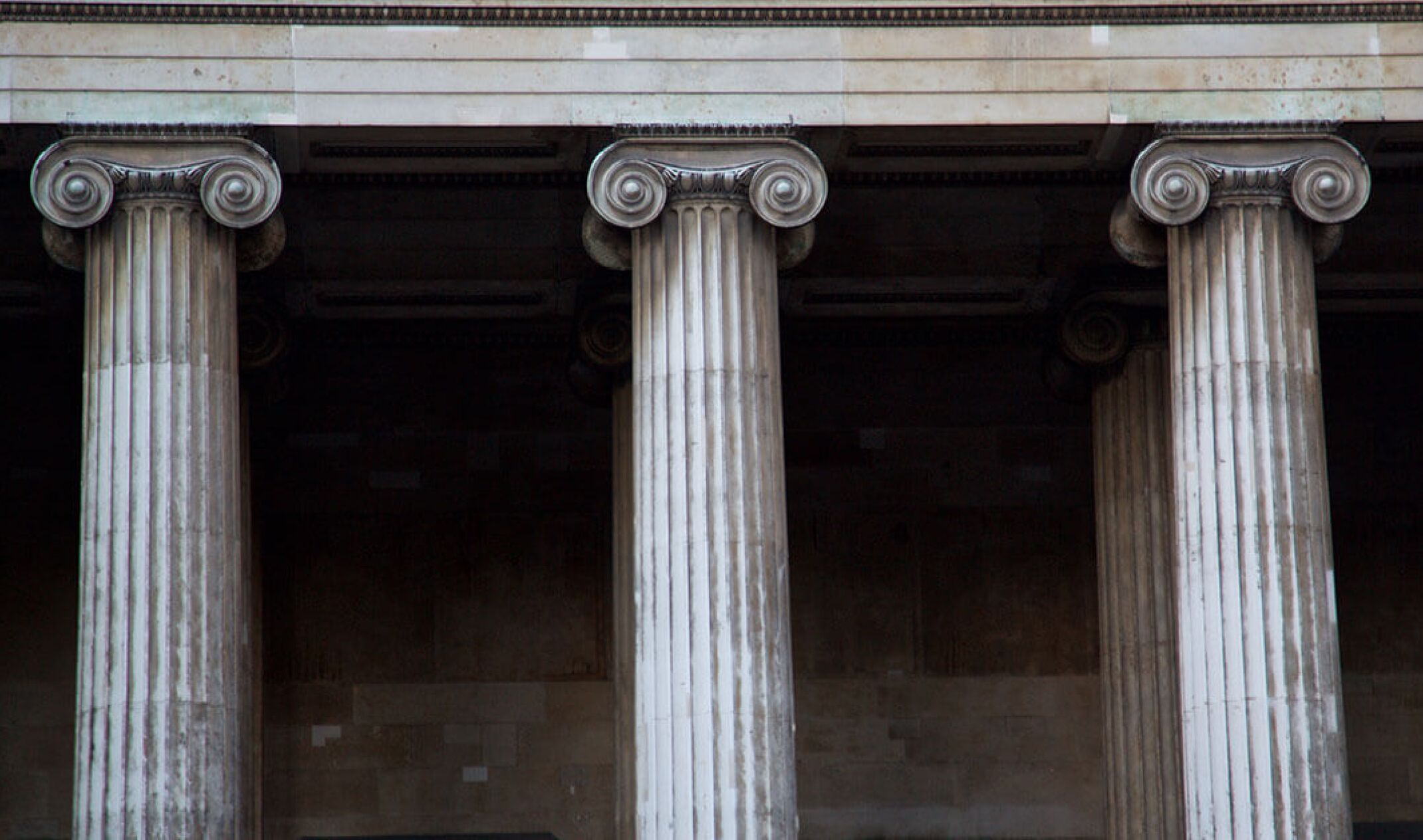 three roman style pillars