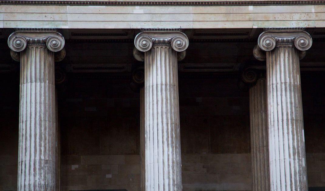 three roman style pillars