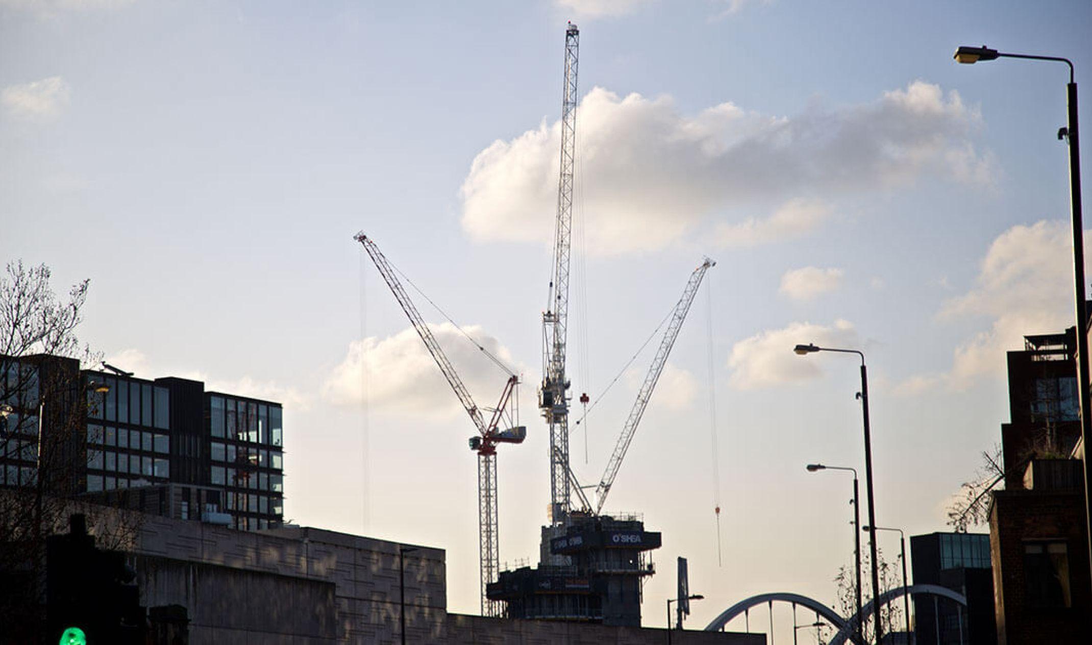 london skyline with three cranes